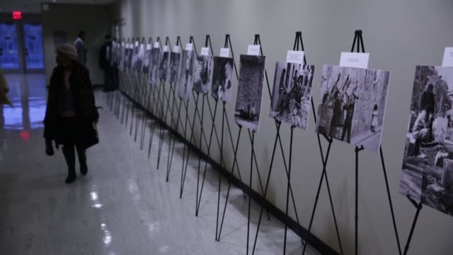 photo exhibition at un headquarters sponsored by the syrian regime has drawn outcry from a prominent opposition group that says the exhibit aims to... - exhibition stock videos & royalty-free footage