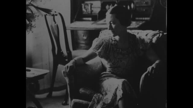 wallis simpson in easy chair in home / edward viii in film circle in middle of screen surrounded by newspaper headlines concerning constitutional... - divorce stock videos & royalty-free footage