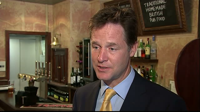a photocall in a london pub was the setting for a show of solidarity by the liberal democrat leadership as it tried to prove its political problems... - british liberal democratic party stock videos and b-roll footage