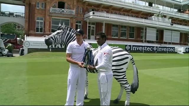 Photocall with England and Sri Lankan Captains ENGLAND London Lords EXT Alastair Cook and Angelo Mathews holding the Investec Series trophy at...