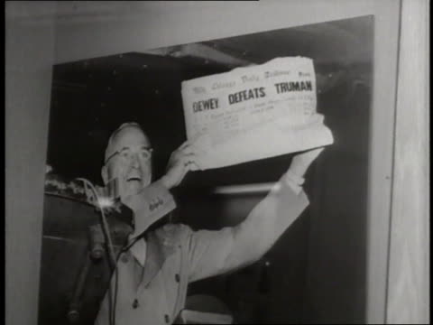 photograph captures president harry s. truman smiling and holding up a newspaper with the headline, dewey defeats truman. - 1948 stock videos & royalty-free footage