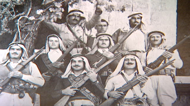 photograph of a group of druze soldiers wearing traditional keffiyehs and posing with their rifles taken during the 1958 revolution. - 1958 stock videos & royalty-free footage