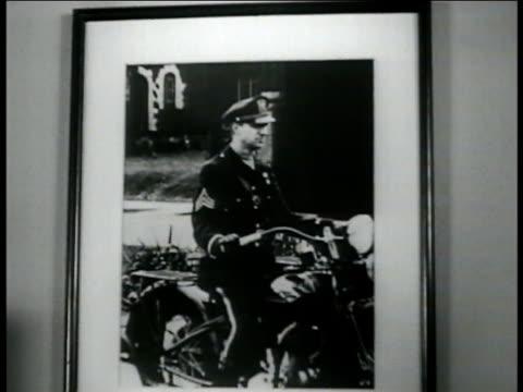 Photograph of Franklin M Kreml as motorcycle policeman MS Kreml doing paperwork at desk CU Registration form for Northwestern University Traffic...