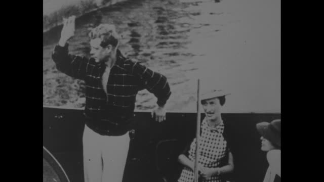 photograph of the couple in a boat / edward duke of windsor in polo shirt and wallis duchess of windsor in casual attire wearing a sun visor / note... - polo shirt stock videos & royalty-free footage