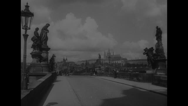 1916 photograph of Vladimir Ilyich Lenin / VS bridge with sculptures in Moscow and the Cathedral of the Immaculate Conception in the far distance /...