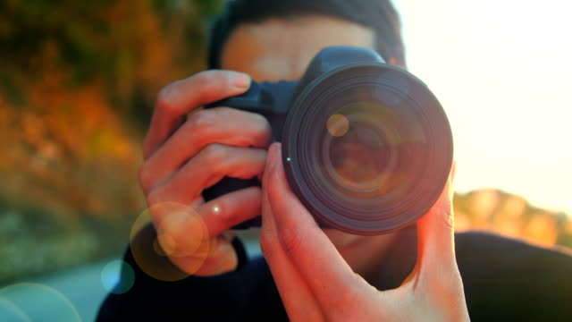 photographer at working - photographing stock videos & royalty-free footage