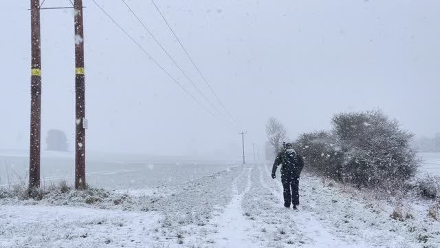 photographer brave blizzard-like conditions on january 24, 2021 in potters bar, united kingdom. parts of the country saw snow and icy conditions as... - hiking stock videos & royalty-free footage