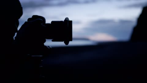 photographer during work. black beach - photographer stock videos & royalty-free footage