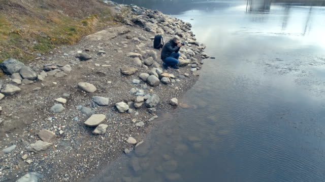 Photographer filming photographing outdoors in nature drone shot