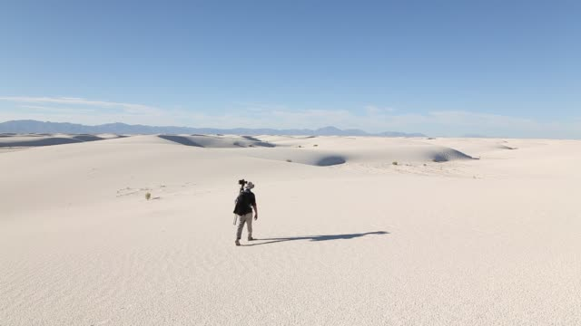 photographer in sand dunes