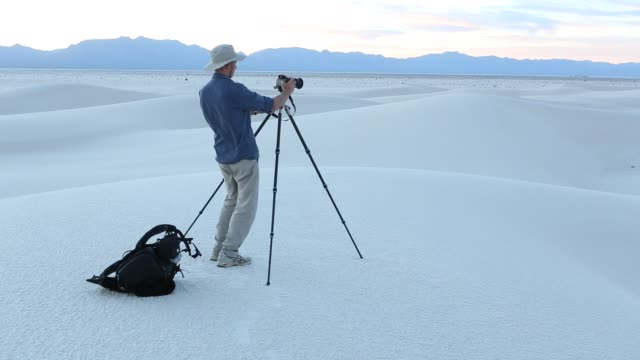 photographer in sand dunes - only mature men stock videos & royalty-free footage