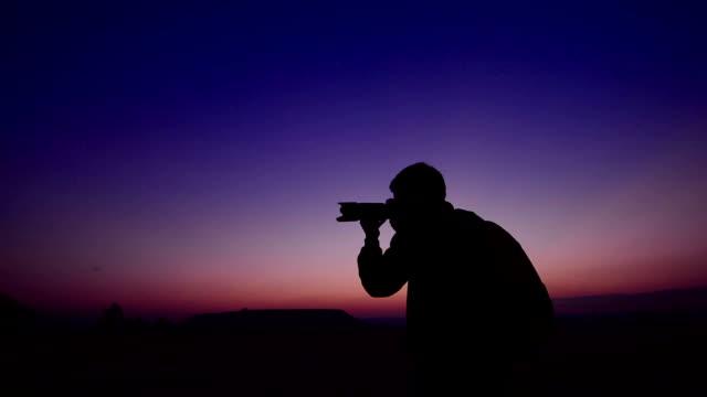 photographer in twilight.