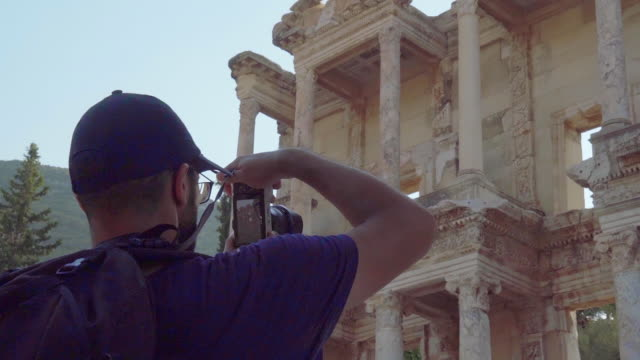 photographer is shooting photos of library of celsus in ephesus ancient city - history stock videos & royalty-free footage