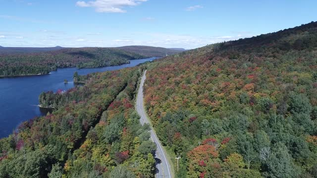 photographer john rowe captured drone footage of fall colors at norton pond, vermont, sharing the results on youtube on september 18. rowe, a local... - vermont stock videos & royalty-free footage