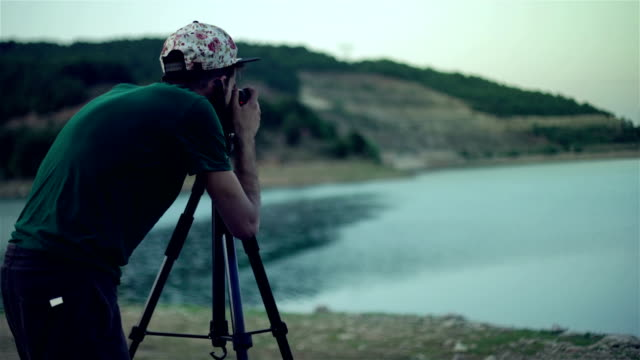 photographer man in the lake - 4k resolution - photographer stock videos & royalty-free footage
