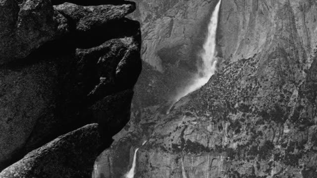 a photographer on glacier point aims his camera toward yosemite falls. - californian sierra nevada stock videos & royalty-free footage