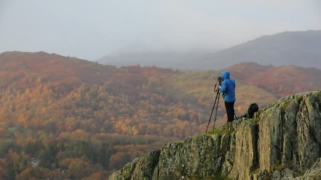 a photographer on todd crag, ambleside, lake district, uk at dawn. - photographer stock videos & royalty-free footage