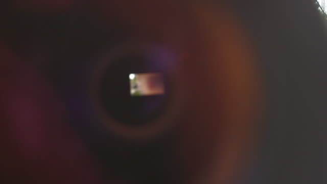 cu of photographer seen through canera lense - looking through an object stock videos & royalty-free footage