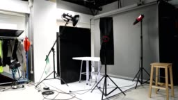 Photographer set up studio room with lighting equipment background in timelapse