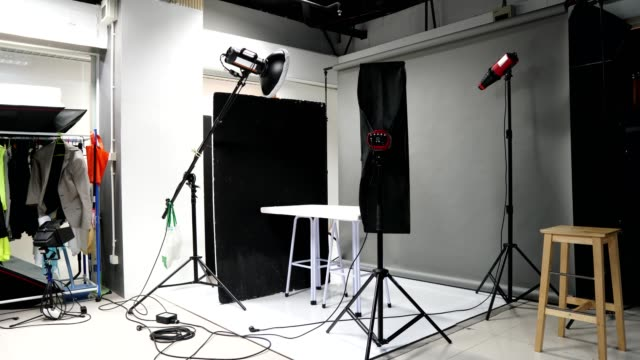 photographer set up studio room with lighting equipment background in timelapse - photographing stock videos & royalty-free footage