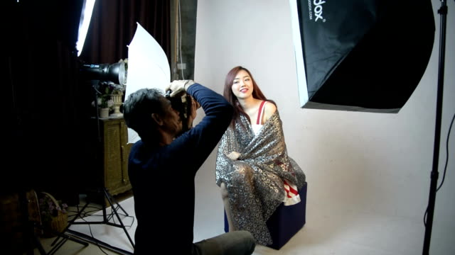 photographer shooting fashion model in the studio. - photo shooting stock videos and b-roll footage
