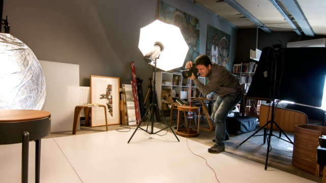 photographer shooting in the studio - camera photographic equipment stock videos & royalty-free footage