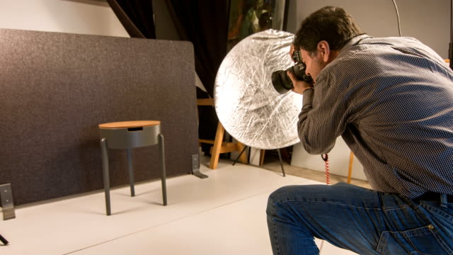photographer shooting in the studio - photo shoot stock videos & royalty-free footage