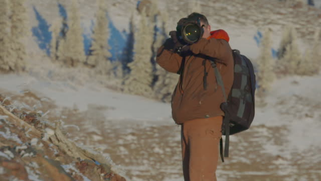 photographer standoff on mountaintop - wilderness stock videos and b-roll footage