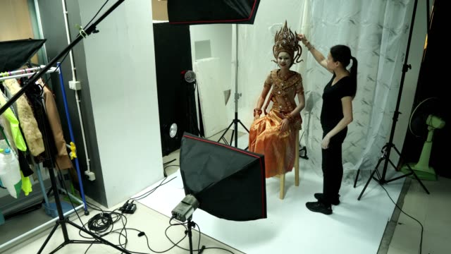 photographer take photo of asian woman model with thai asia traditional costume - photographing stock videos & royalty-free footage