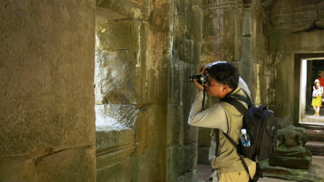Photographer takes photographs in Angkor Wat Temple
