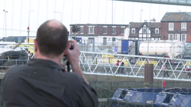 photographer takes photos of migrants arriving in port aboard a border force vessel after being intercepted while crossing the english channel from... - video stock videos & royalty-free footage