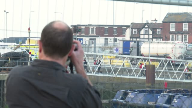 photographer takes photos of migrants arriving in port aboard a border force vessel after being intercepted while crossing the english channel from... - photographing stock videos & royalty-free footage