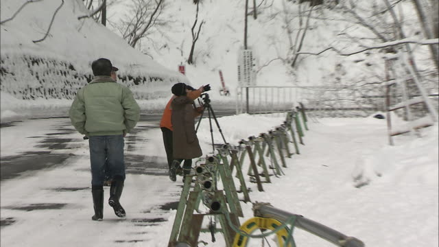 A photographer takes pictures of artificial icicles in Karuizawa, Japan.