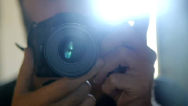 photographer  taking photos indoors. - photo shoot stock videos & royalty-free footage