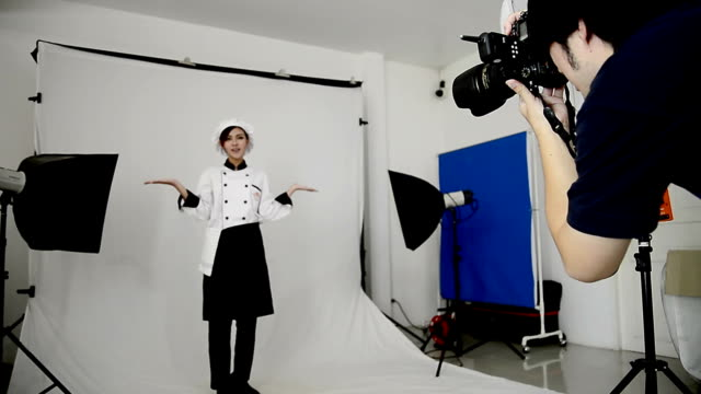 photographer taking pictures of woman chef in the studio - human face photos stock videos & royalty-free footage