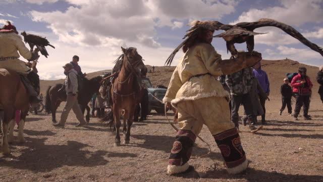Photographers and Kazakh Eagle Hunters in Mongolia at Golden Eagle Festival
