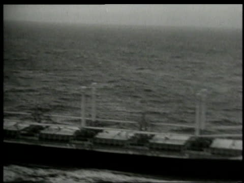 photographers behind cameras / jfk speaking at microphone / ship at sea / navy man looking through periscope / - cuban missile crisis stock videos & royalty-free footage