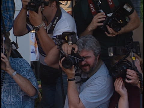 photographers on th line at the theres something about mary premiere at manns village theater westwood in westwood ca - regency village theater stock videos & royalty-free footage