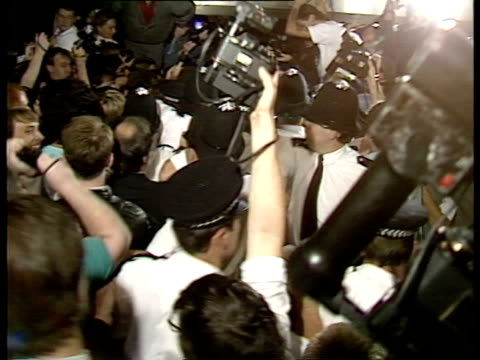photographers rushing to get photos of madonna after her arrival at heathrow airport for british tour on august 13 1987 / london england/ audio - surrounding stock videos and b-roll footage