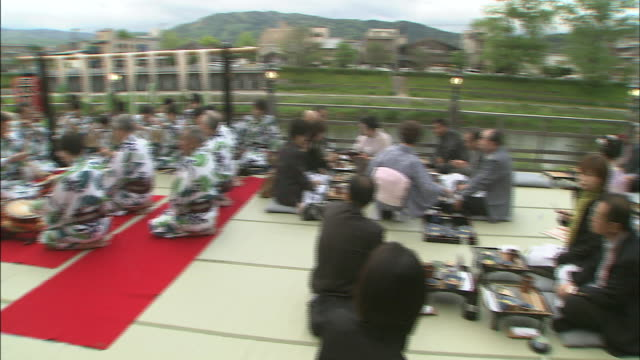 Photographers snap pictures of musicians and dinner guests on the Noryo-Yuka.