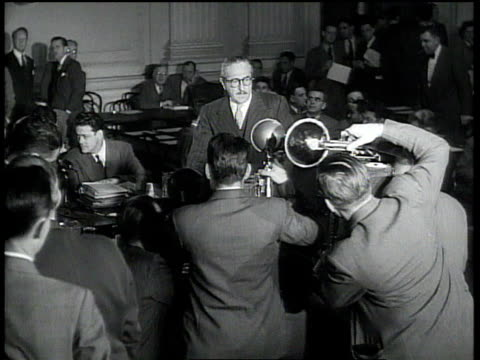 photographers snapping actor adolphe menjou before his testimony at the house committee on unamerican activities / washington dc united states - house committee on unamerican activities stock videos & royalty-free footage