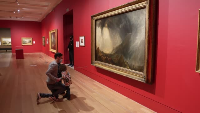 """photographers take photos of models infant of jmw turner's artwork during the """"turner and the modern world"""" press view at tate britain on october 26,... - photographing stock videos & royalty-free footage"""