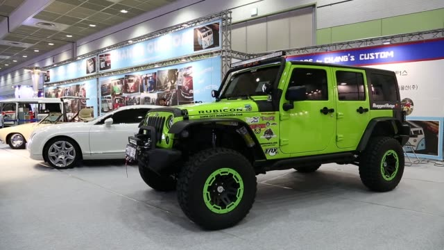 photographers take photos of models with supercars at the seoul auto salon 2013 in seoul south korea on thursday july 11 models pose by super cars... - querfeldeinrennen stock-videos und b-roll-filmmaterial