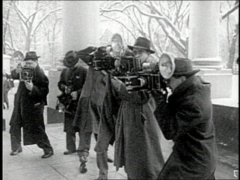 photographers take photos on the porch of the white house during winter - photojournalist stock videos & royalty-free footage