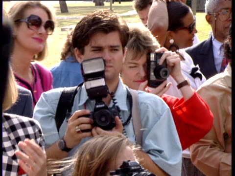 Photographers take pictures as Hillary Clinton chats to public Texas 1992