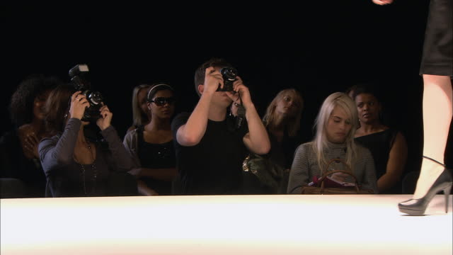 ms pan photographers taking pictures as model walks on catwalk at fashion show/ london, england - fashion show stock videos & royalty-free footage