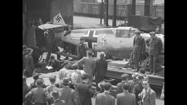 photographers with a messerschmitt's bent propellers in a container a shot from inside the structure / the fuselage of the plane and men in uniform... - straw hat stock videos & royalty-free footage