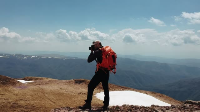 photographing beautiful mountain nature - photographer stock videos and b-roll footage