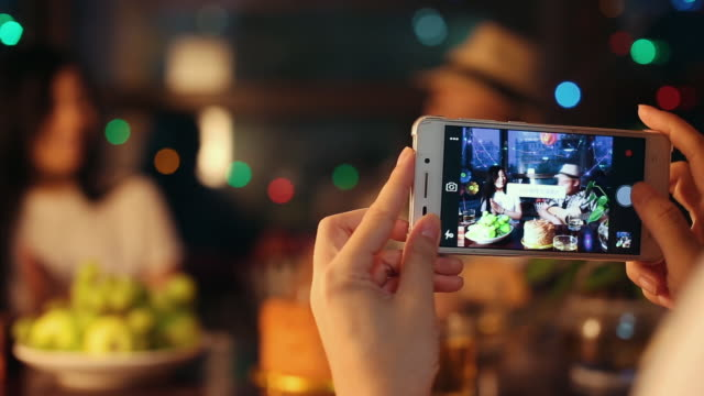 photographing friends at party - filming stock videos & royalty-free footage