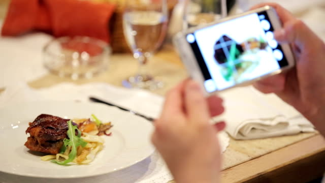 photographing healthy lunch on a smartphone - photographing stock videos and b-roll footage